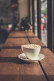 A cup of coffee. On the table with a warm light in the evening Stock Images