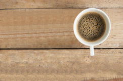 Cup of coffee on  table wood vintage background in top view. Stock Photo