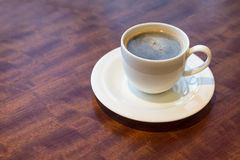 Cup of Coffee on table. Cup of Coffee on wooden table in cafe Stock Images