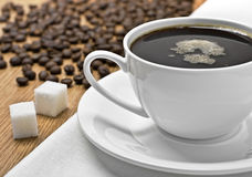 Cup of coffee on a tablecloth Stock Photos