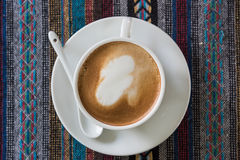 Cup of coffee on tablecloth. Close up cup of coffee on tablecloth Royalty Free Stock Image