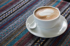Cup of coffee on tablecloth. Close up cup of coffee on tablecloth Stock Photography