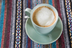Cup of coffee on tablecloth Stock Photo