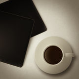 Cup of coffee and tablet computer as vintage style Stock Photography