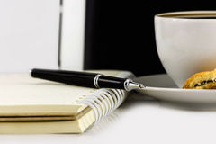 Cup of coffee,tablet computer,book and pen Stock Photos