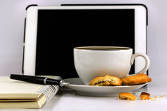 Cup of coffee,tablet computer,book and pen Stock Images