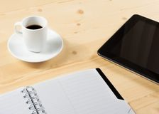 Cup of coffee and tablet near notes, concept of new technology Royalty Free Stock Photo