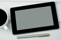 Cup of coffee with tablet pc and fountain pen Stock Image