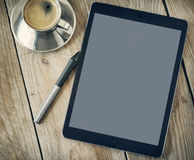 Cup of coffee and tablet. Stock Photography