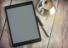 Cup of coffee and tablet. Stock Photos