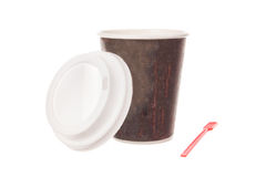 Cup of coffee for take away with cap and spoon. Opened take away coffee with cap; cardboard vending coffee cup; opened take-out coffee cup with plastic spoon Stock Photography