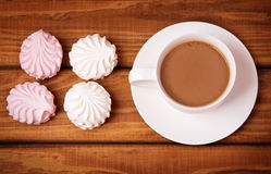 Cup of coffee and tasty cakes Royalty Free Stock Photo