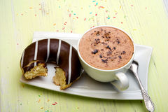 Cup of coffee and tasty donuts with icing and chocolate Stock Photo