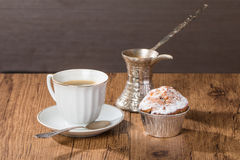 Cup of coffee with tasty muffins and turk for coffee Stock Photo