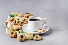 Cup of Coffee and Tasty Turkish Delight Oriental Dessert Lokum and Oriental Cookies Copy Space.  stock photos