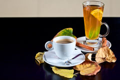 Cup of coffee and tea with autumn leaves Stock Photos