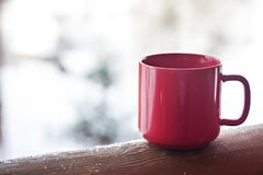Cup with coffee, tea on the background of the winter landscape. A cup with a hot drink on the background of the winter forest. the table outdoor in the winter stock photos