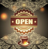 Cup of coffee or tea with badge open and lace on blur background Stock Image