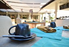 A cup of coffee or tea on breakfast table at a resort royalty free stock photo