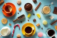 Cup of coffee, tea and cacao at blue background Royalty Free Stock Photography