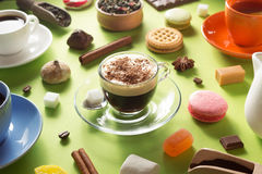 Cup of coffee, tea and cacao at green background Stock Photo