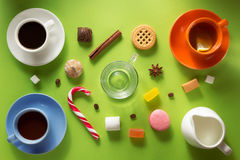 Cup of coffee, tea and cacao at green background Stock Images