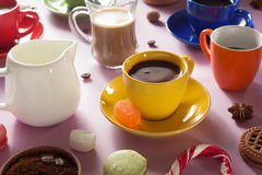 Cup of coffee, tea and cacao at purple background Stock Photography