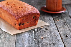 Cup of coffee or tea with a cherry cake on a wooden dinner-table Stock Image