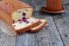Cup of coffee or tea with a cherry cake on a wooden dinner-table Stock Photo