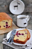 Cup of coffee or tea with a cherry cake on a wooden dinner-table Stock Photography
