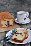 Cup of coffee or tea with a cherry cake on a wooden dinner-table Royalty Free Stock Photography
