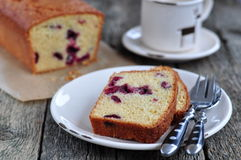 Cup of coffee or tea with a cherry cake on a wooden dinner-table Royalty Free Stock Photos