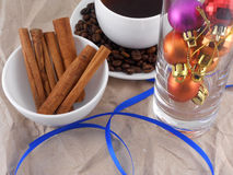 Cup of coffee or tea with cinnamon, coffee beans and christmas balls Stock Photography