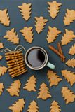 A cup of coffee or tea with cinnamon and ginger christmas cookie stock images