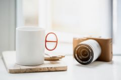 Cup of coffee   and classic camera on white table Royalty Free Stock Photos