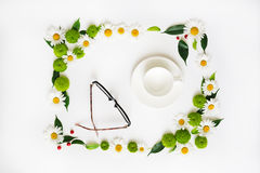 Cup for coffee or tea and glasses with wreath frame. Royalty Free Stock Photography