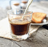Cup of coffee, tea spoon on a napkin on gray wooden background Stock Photos