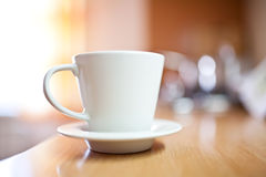 Cup of coffee or tea on wooden table Stock Images