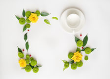 Cup for coffee or tea with wreath frame from roses and other flo Royalty Free Stock Photography