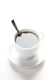 Cup of coffee with teaspoon and sugar slices Stock Images