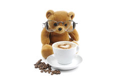 Cup of coffee and a teddy bear Royalty Free Stock Photo