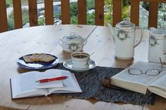 Cup of coffee on the terrace, relax with a book Royalty Free Stock Images