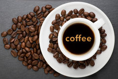 Cup of coffee with text Stock Photography