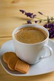 Cup of coffee and three lemon biscuits on saucer Royalty Free Stock Photos