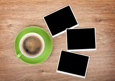 Cup of coffee and three photo frames Royalty Free Stock Images