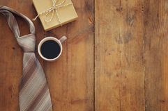 cup of coffee, tie and gift box. Father& x27;s day concept royalty free stock image