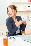 A cup of coffee to feel good during working hours Stock Images