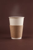 Cup of coffee to go. On brown backgrownd with place for text and logo Royalty Free Stock Images