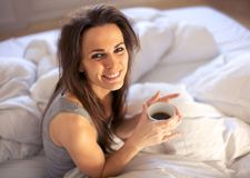 With a Cup of Coffee to Start the Morning Right Stock Photography