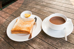 Cup of coffee toast with butter. On wooden table Royalty Free Stock Photos